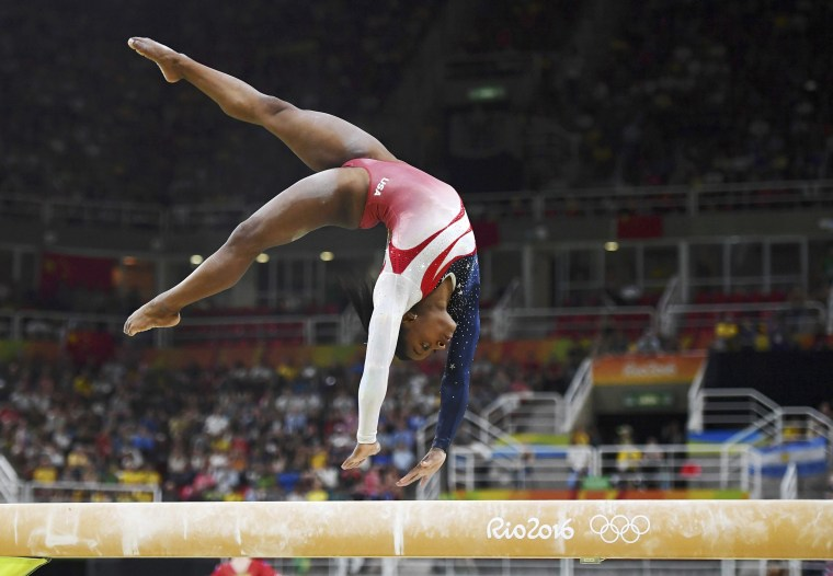 Image: Simone Biles competes on the beam for Team USA