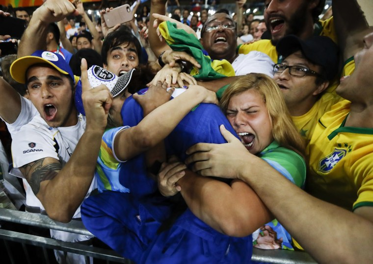 Image: Brazil's Rafaela Silva celebrates with supporters after winning the gold medal
