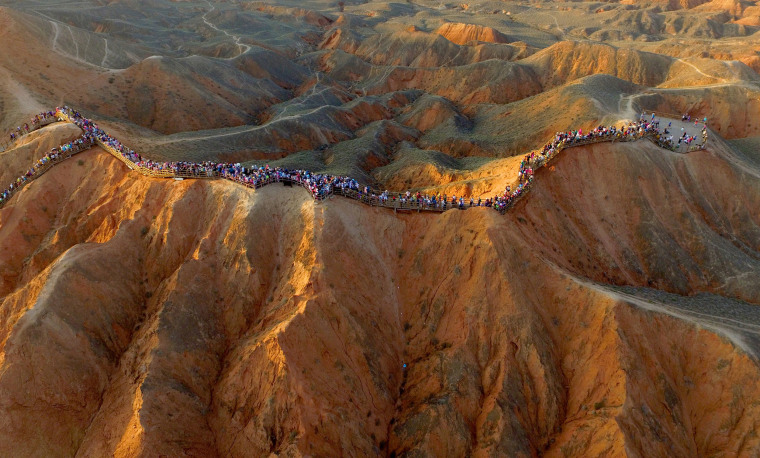 Image: People visit an area of Danxia landform in China