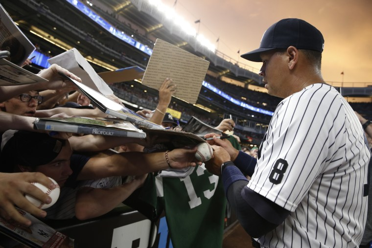 Yankees baseball player Alex Rodriguez, known as A-Rod, signing autographs at his last game at Yankees stadium in the Bronx, Aug. 12, 2016.