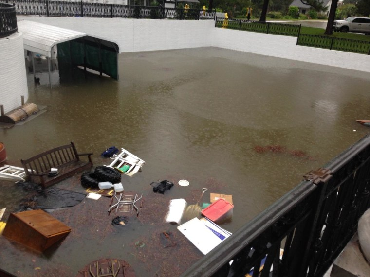 Floodwaters inundate the Louisiana Governor's Mansion in Baton Rouge. The basement of the mansion has flooded and the governor's family was relocated to another place to live until the situation is resolved, officials said.