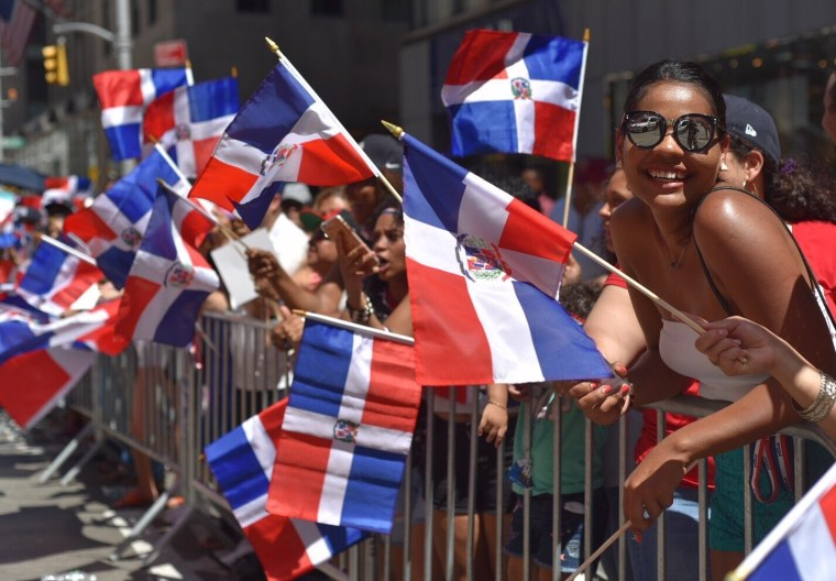 Spectators beat the heat to participate in the Dominican Day Parade in New York City.