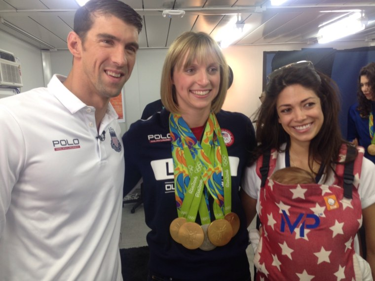 Katie Ledecky, Michael Phelps and Phelps' fiancee, Nicole Johnson