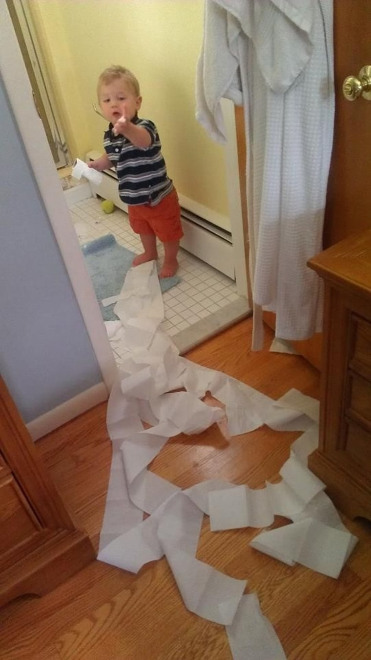 Little boy makes a big mess with toilet paper