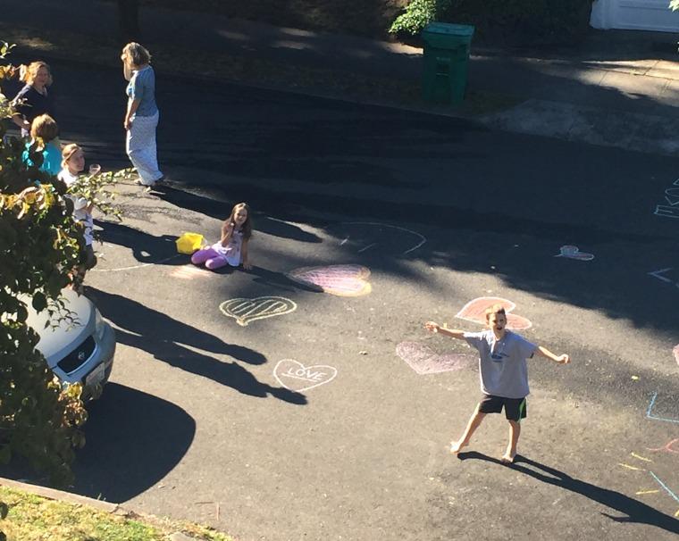 kids washing away graffiti