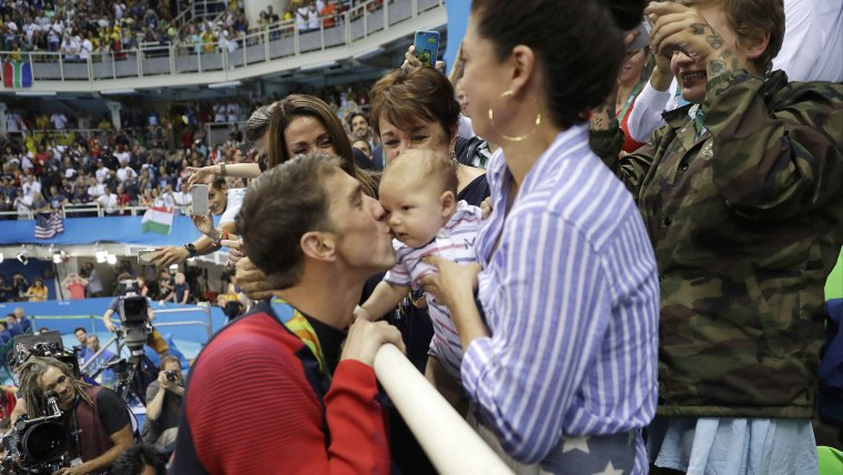 Michael Phelps with Baby boomer, mother, fiance