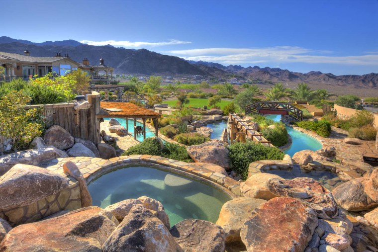 Home with a lazy river in the backyard