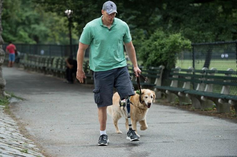 U.S. Navy Corpsman Joe Worley and his service dog, golden retriever Benjamin.