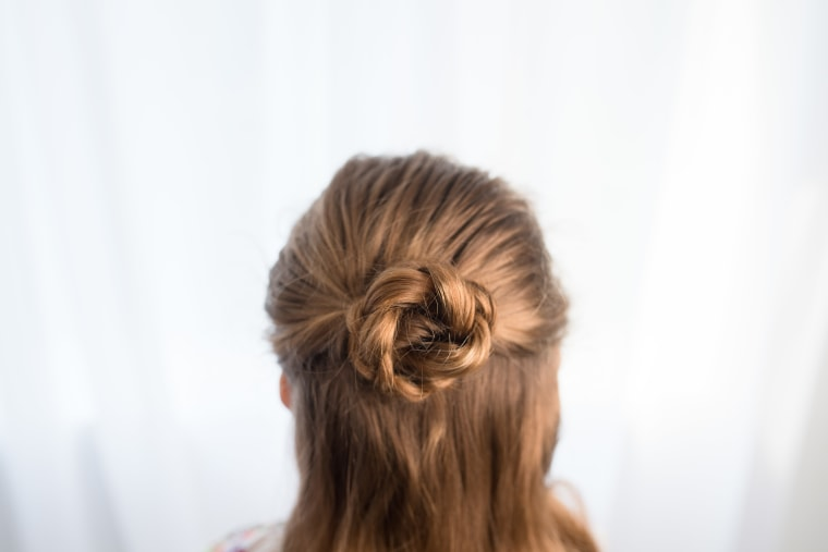 Half braided up-do hairstyle for kids