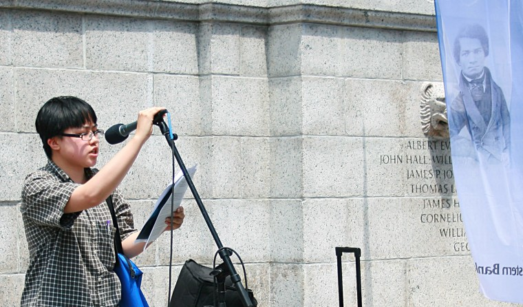 """Lydia X. Z. Brown participating in the annual communal reading of Frederick Douglass' """"What To The Slave Is The Fourth of July?"""" at the Boston Common, July 2015."""