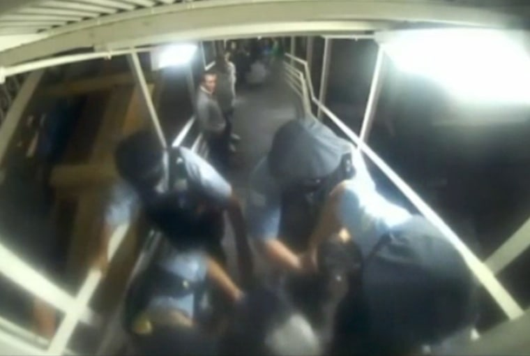 A still taken from a video released by the Chicago Transit Authority seemingly showing the arrest of Itemid Al Matar