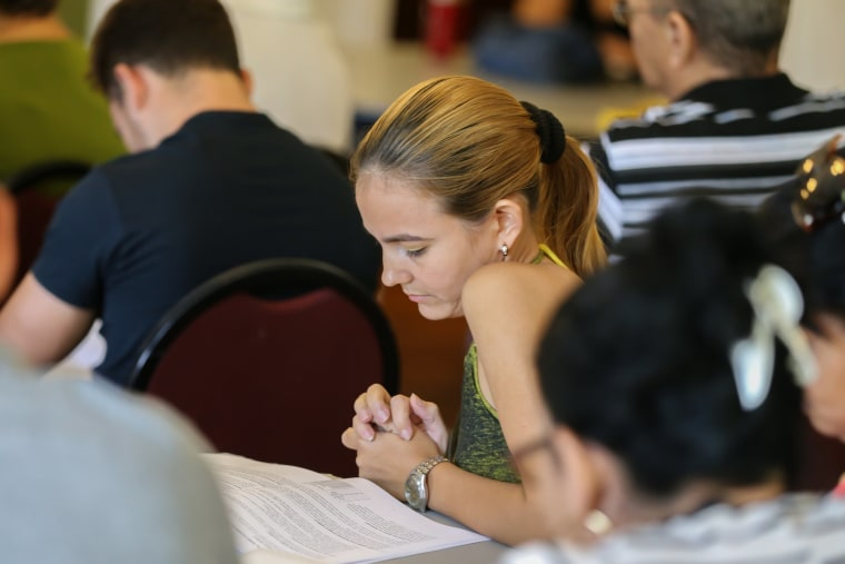 Immigrants who arrived recently from Cuba attend an orientation session at Kentucky Refugee Ministries in Louisville.