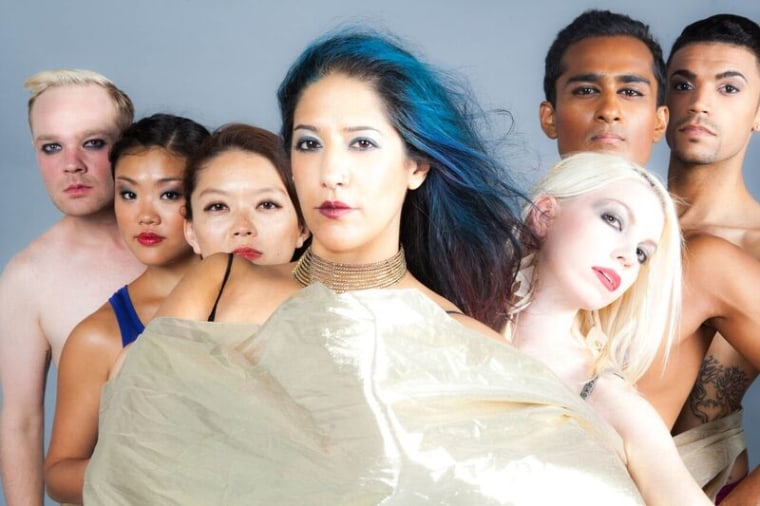 Achinta McDaniel poses in the center of the Blue13 Dance Company.