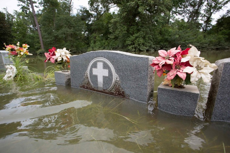 Image: The floodwaters recede from Bethel United Methodist Cemetery in Greenwell Springs