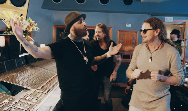 Behind the scene with Nicky Jam and Mana.