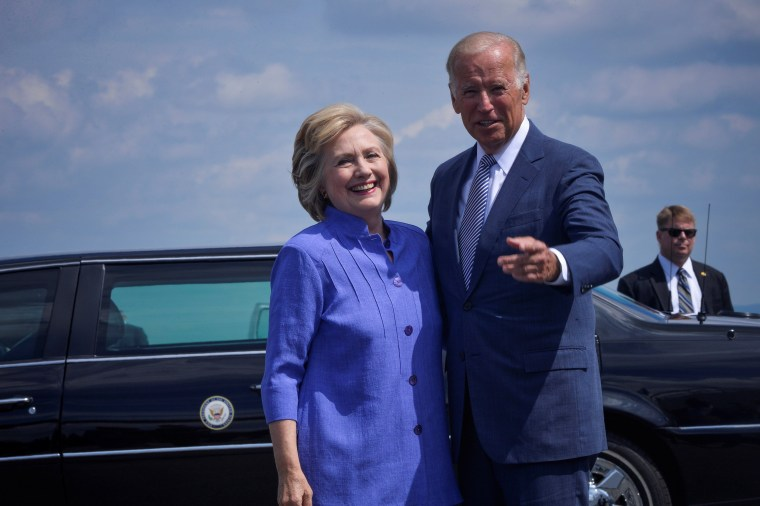 Image: Democratic presidential nominee Hillary Clinton welcomes Vice President Joe Biden as he disembarks from Air Force Two for a joint campaign event in Scranton, Pennsylvania