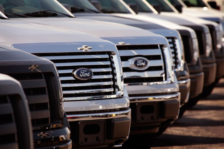 Image: Ford vehicles are offered for sale at a dealership