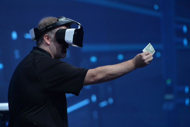 Intel's Craig Raymond displays the Project Alloy virtual reality headset during the Day 1 keynote at the 2016 Intel Developer Forum in San Francisco on Aug. 16, 2016.