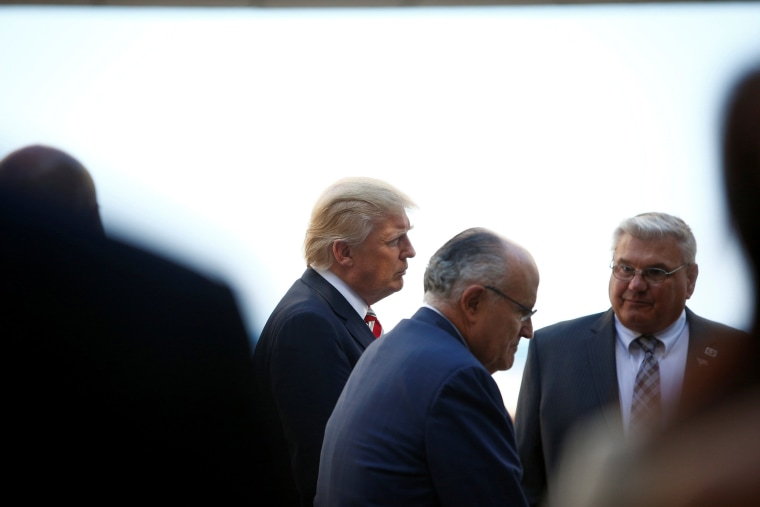 Image: Republican U.S. presidential nominee Donald Trump, former New York mayor Rudy Giuliani and David Drent, executive director of the Milwaukee County War Memorial Center tour the facility in Milwaukee, Wisconsin