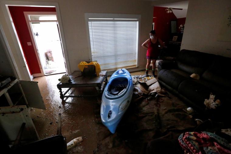 Image: Johnette Folse stands in her flood damaged living room in Denham Springs