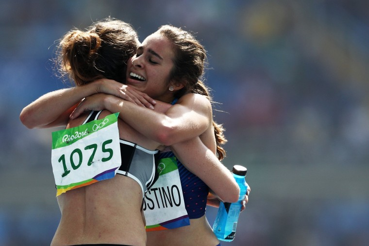 Image: Abbey D'Agostino of the United States (R) hugs Nikki Hamblin of New Zealand