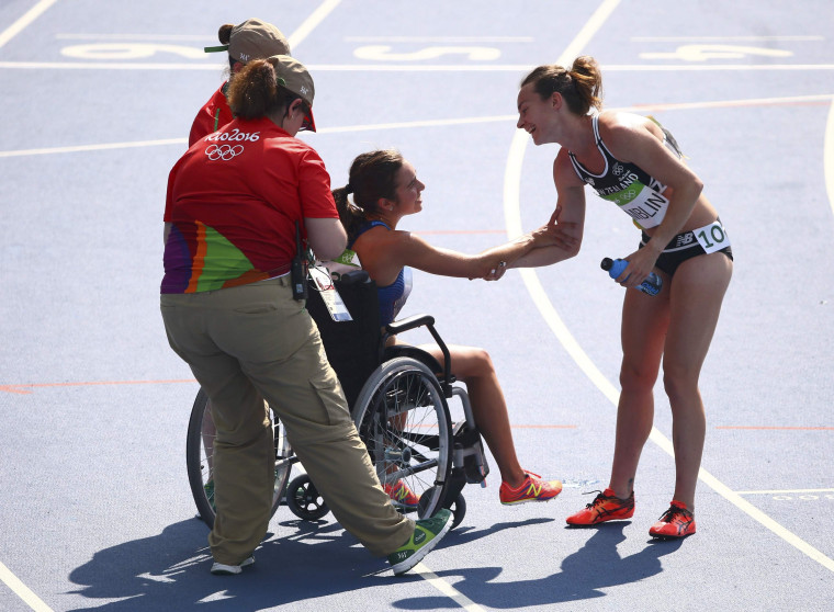 Image: Abbey D'Agostino (USA) of USA thanks Nikki Hamblin (NZL) of New Zealand after finishing the race.