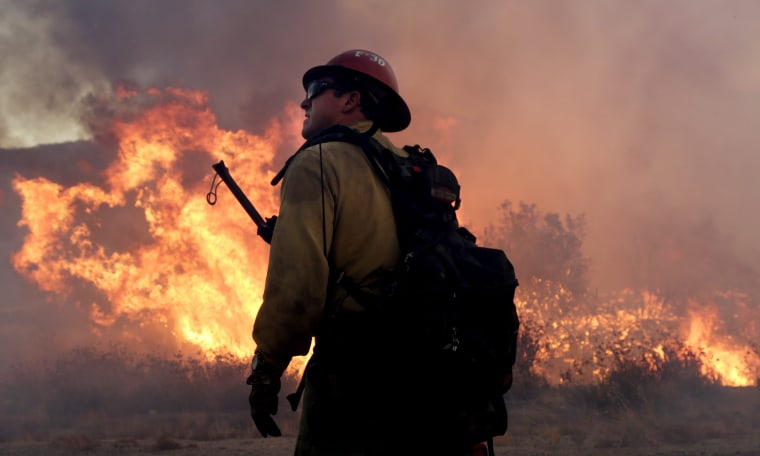 Image: A firefighter battles the Blue Cut fire near Los Angeles which has led to evacuated orders for 82,000 people.