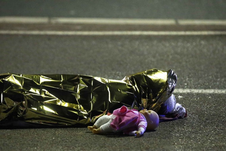 Image: A body and doll on ground after truck attack in Nice