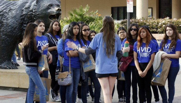 UCLA campus tour guide Samantha St. Germain leads prospective college-bound high school seniors on a campus tour in Los Angeles on Feb. 26, 2015.