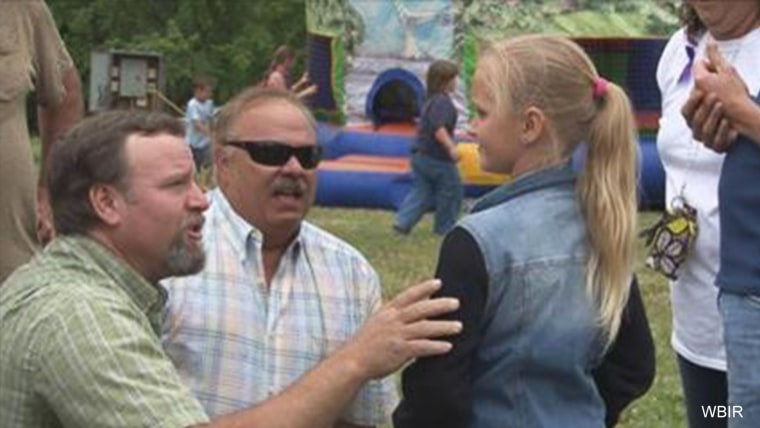 Carlie Trent (right) and two of the men who helped rescue her.