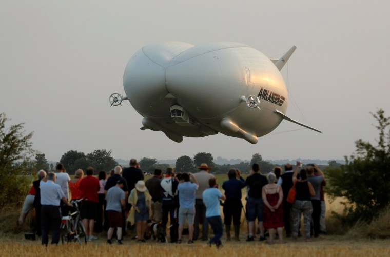 Image: The Airlander 10 hybrid airship makes its maiden flight at Cardington Airfield in Britain