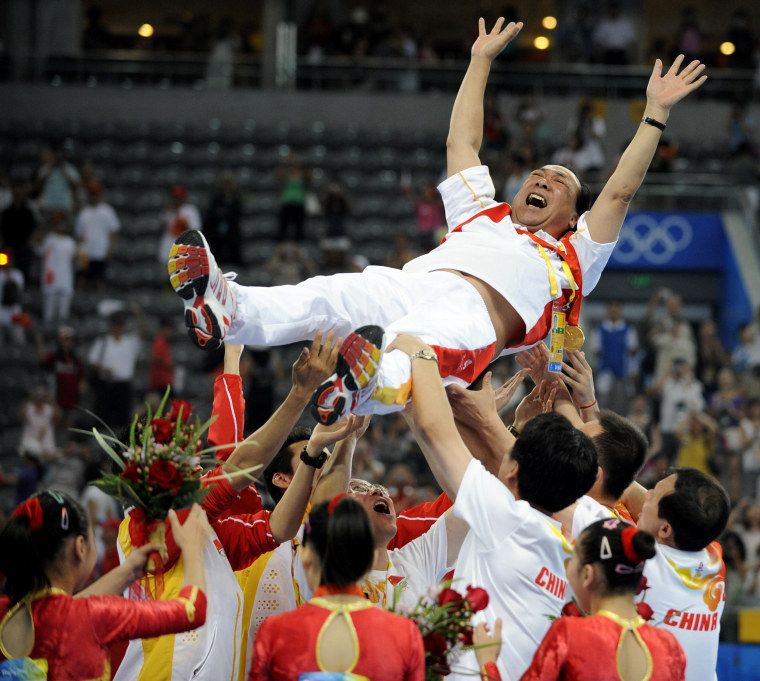 Image: Chinese gymnast lift Gao Jian in 2008