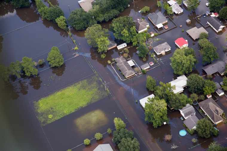 Image: Contaminated floodwaters impact a neighborhood as seen in an aerial view in Sorrento, Louisiana