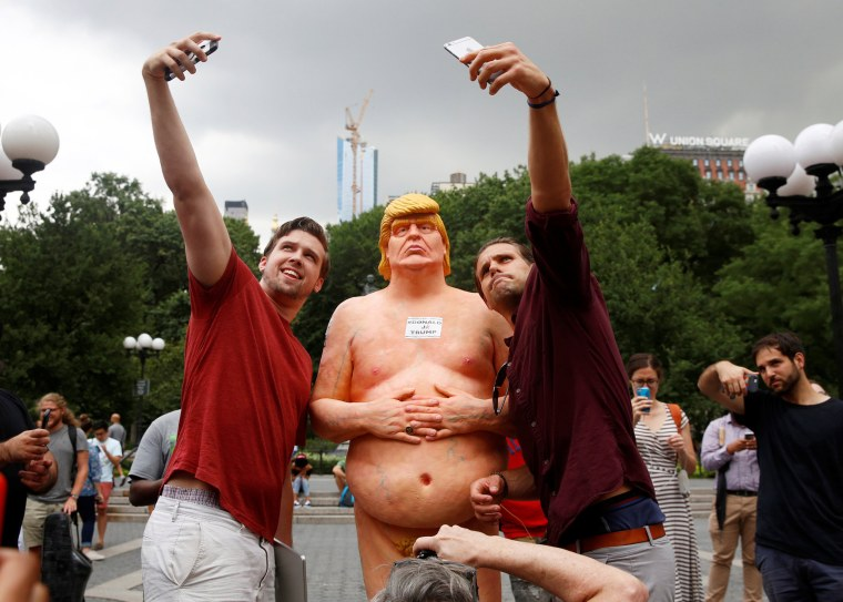 Image: People pose for selfies with a naked statue of U.S. Republican presidential nominee Donald Trump that was left in Union Square Park in New York