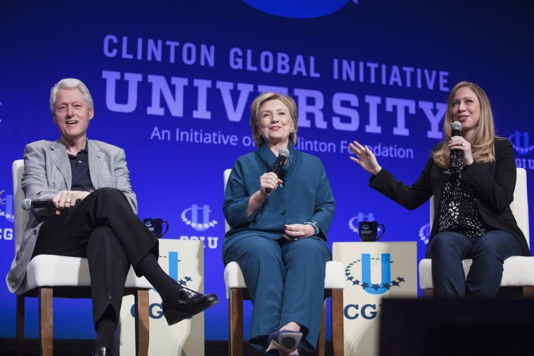 Image: Bill, Hillary and Chelsea Clinton, discussing Clinton Global Initiative University during closing plenary session on second day of 2014 Meeting of Clinton Global Initiative University at Arizona State University in Tempe
