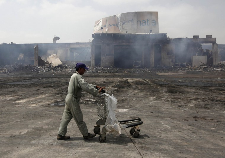 Image: Militant attacks are fairly common in Karachi, such as the 2014 battle that destroyed buildings at the city's international airport
