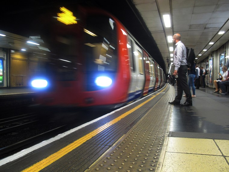 An underground train arrives at St. James's Park in London on Aug. 17.