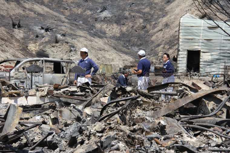 Tzu Chi volunteers in the aftermath of the Santa Clarita wild fire in California.