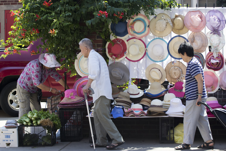 Customers stroll by sidewalk shops set up in Philadelphia's industrial Chinatown area.