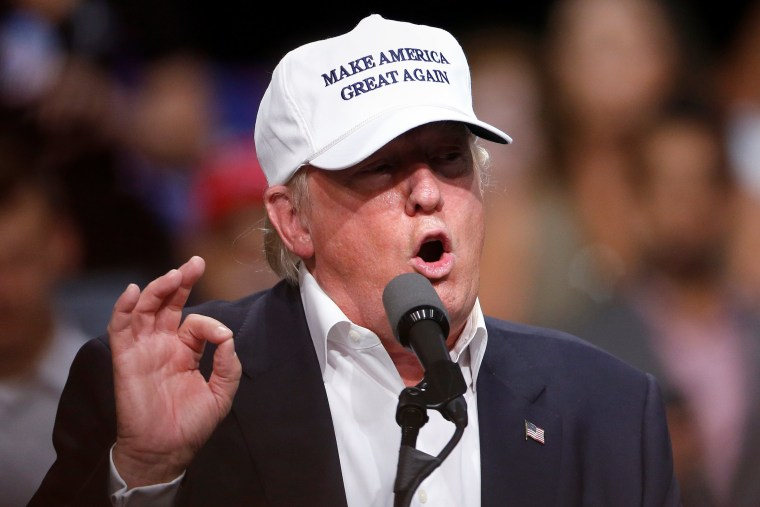 Image: Republican presidential nominee Donald Trump speaks on stage during a campaign event in Dimondale
