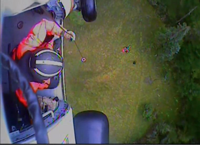 The U.S. Coast Guard hoists wilderness guides mauled by bears in Alaska.
