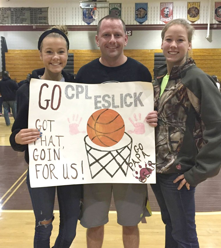 Eslick's chalkboard back-to-school sign was designed by his wife, April.