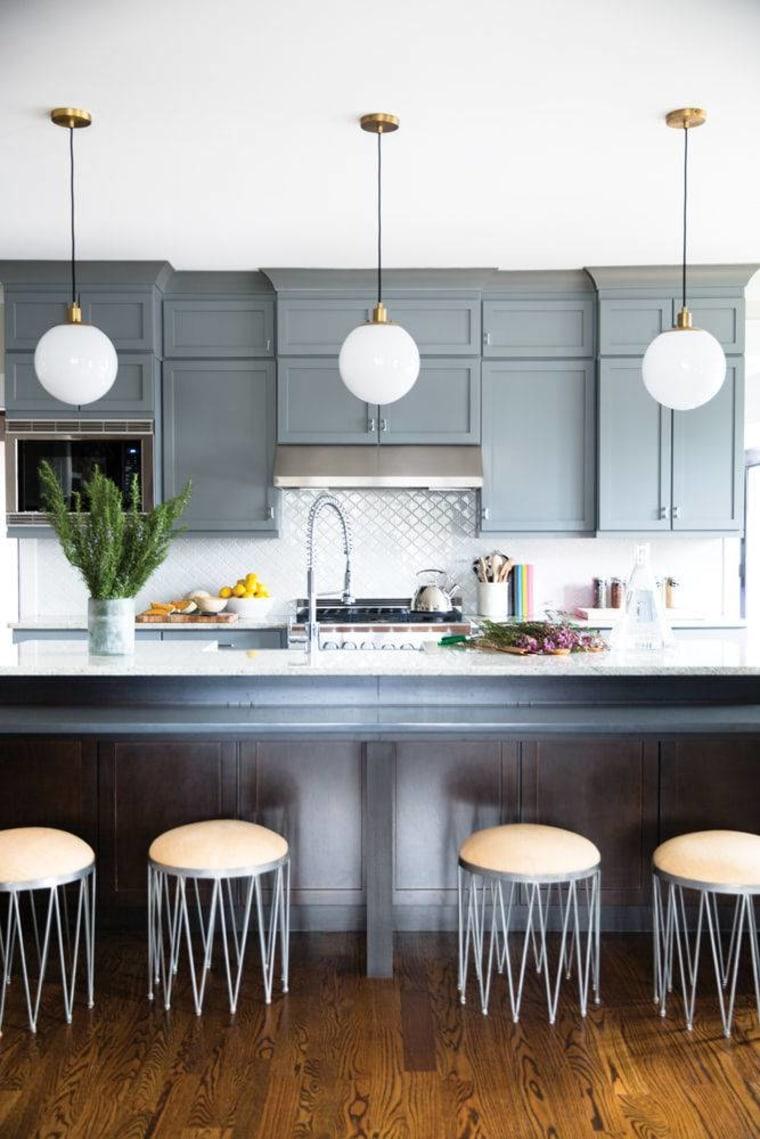 Milk-finish globe pendants make a bright style statement in the kitchen.