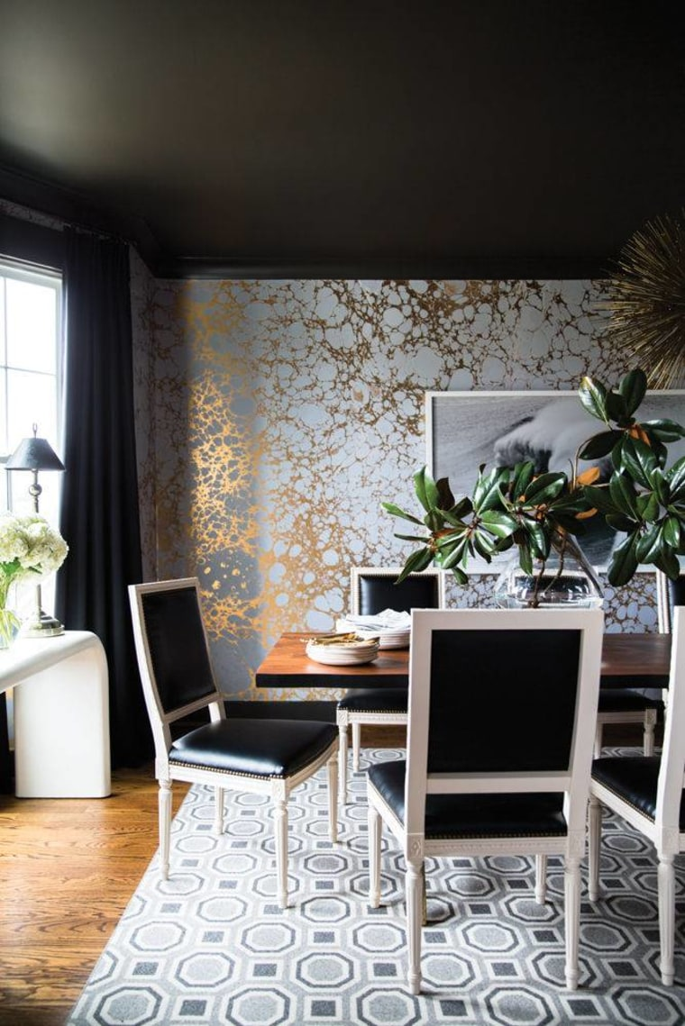 Shimmering metallic wallpaper makes a bold style statement in the dining room.