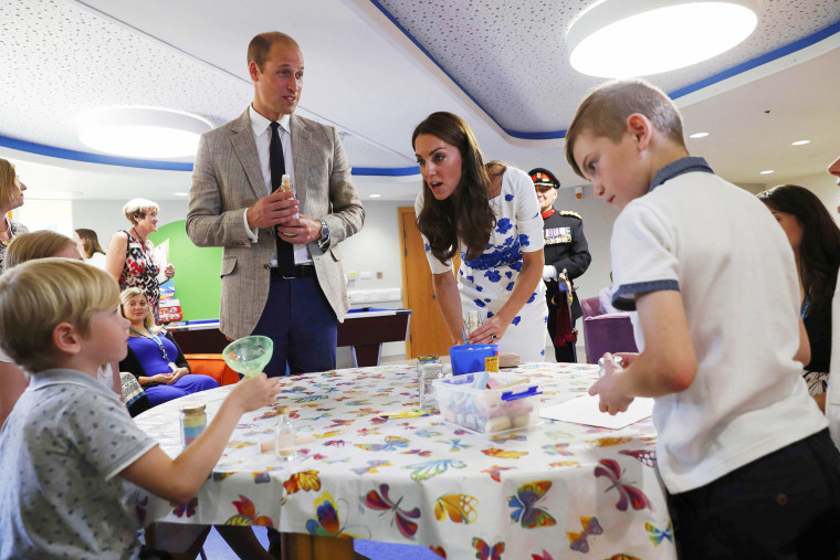 Prince William and Catherine, Duchess of Cambridge, are presented with a personalised memory jar during their visit to Keech Hospice Care in Luton