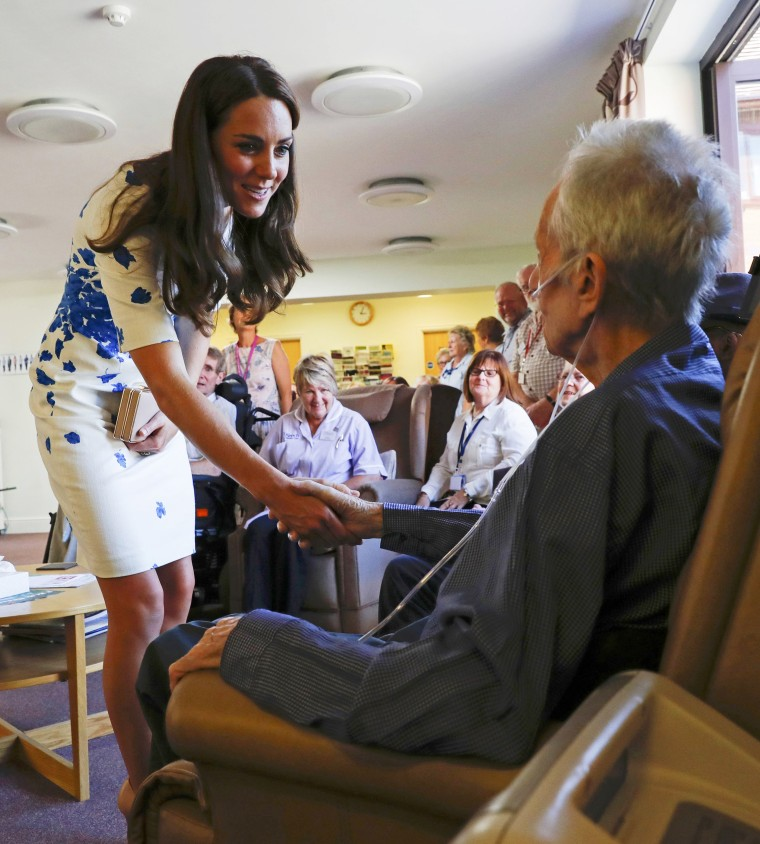Catherine, Duchess of Cambridge, shakes hands with a patient during her visit to Keech Hospice Care in Luton