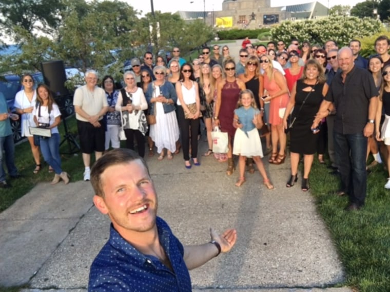 Josh Schmitz proposed to Danielle Roesch in front of 50 friends and family members.