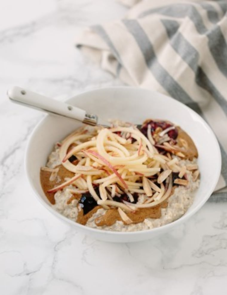 Oatmeal bowl with spiralized apples and toasted almonds
