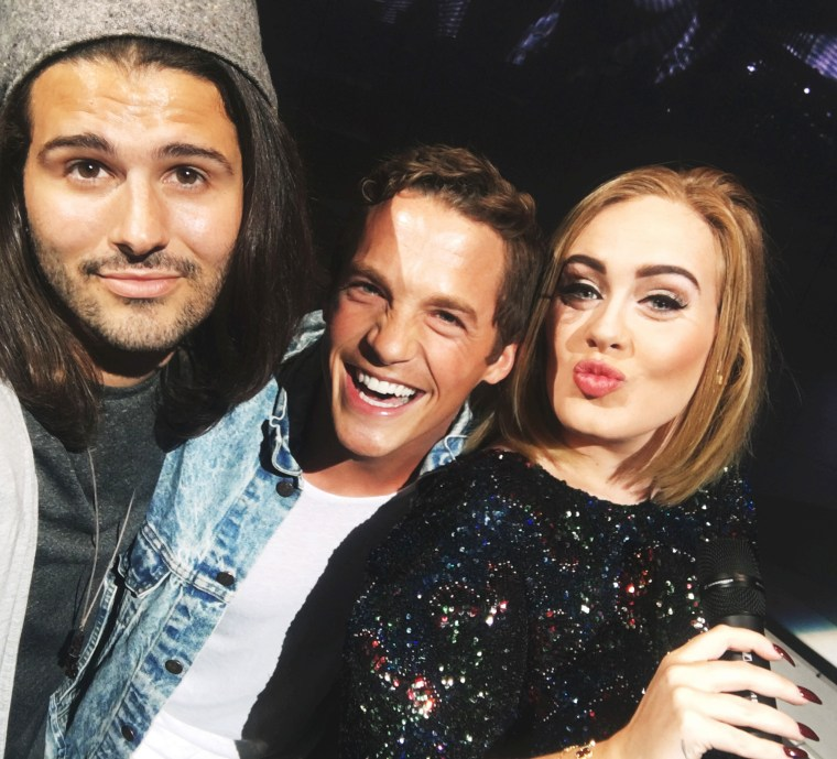 Vince Rossi and Ryan Salonen, two Adele fans that got chosen by the singer to join her onstage at her Los Angeles concert on August 9 in Los Angeles.