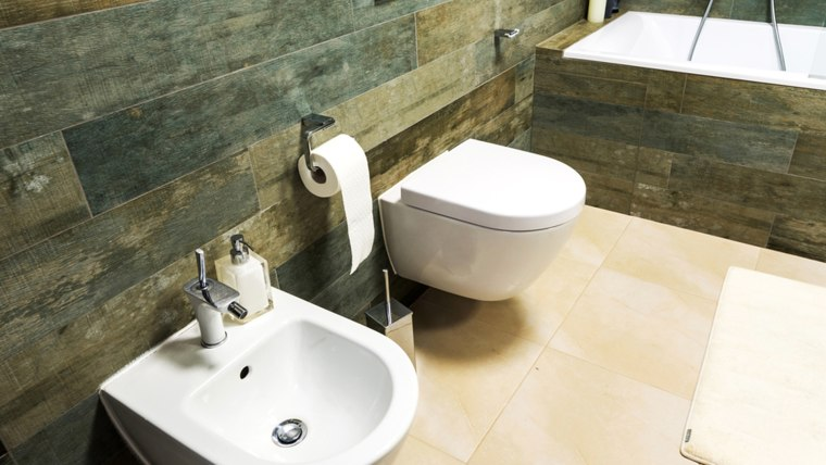 The bidet gets the job done using a stream of water.